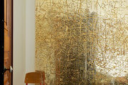 A galvanized copper piece by Rudolph Stingel next to the Standard Chair by Jean Prouvé