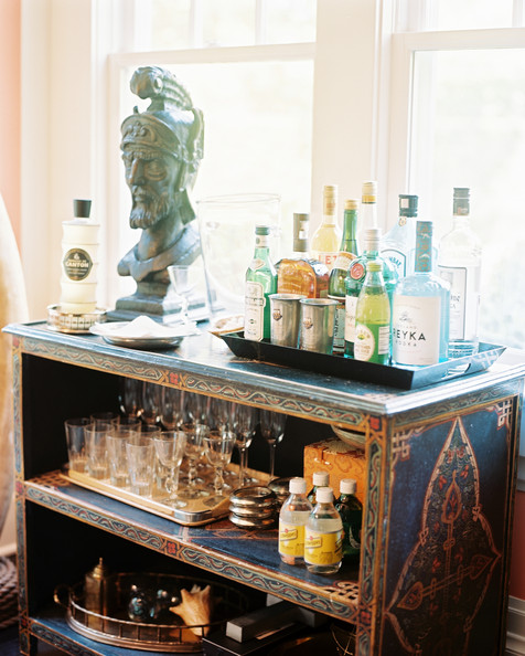 Bar - Trays of bar essentials and glassware surrounding a bust