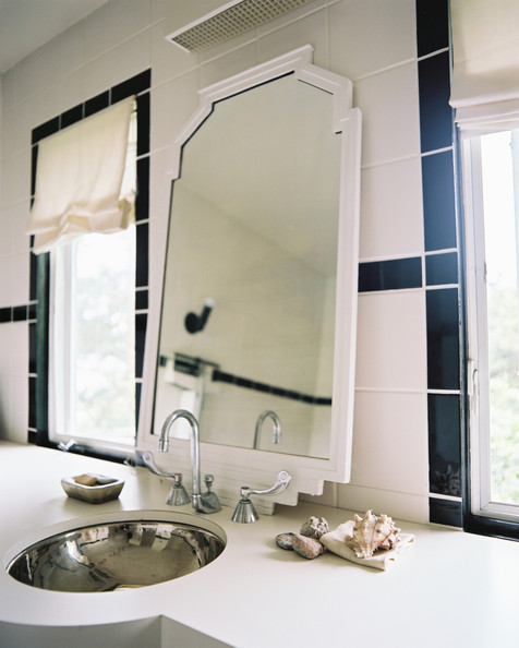 modern bathroom a white mirror and black and white tile in a bathroom ...