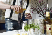 A bartender mixes up a mint julep