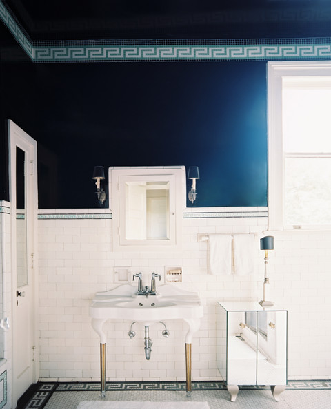 blue wall treatment greek key tile borders in a bathroom with white