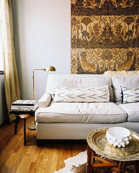 Bohemian Living Room A Tapestry Hung Behind A White Couch With A