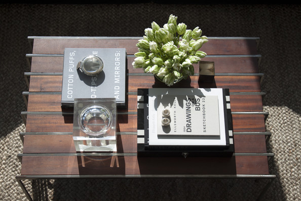 Books - Flowers, books, and decorative objects on a wooden coffee table