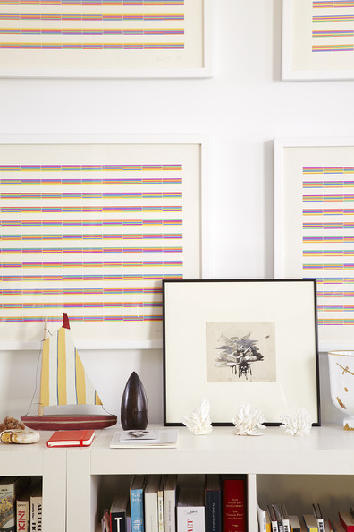 Books - A grouping backed by striped prints by Laura Grisi.