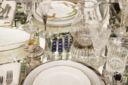 Formal place settings on a mirrored tabletop