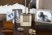 A desk display with a family photo and mementos