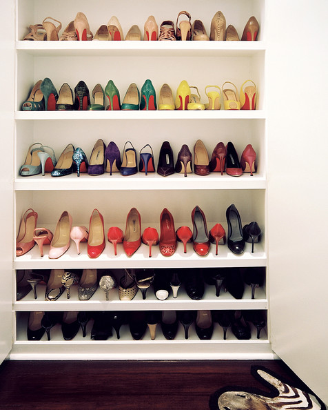closet shoes on display on white shelving details closet multicolored
