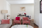 This living room is decorated in white and pink.