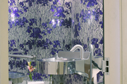 Floral-motif wallpaper in a bathroom