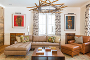 An eclectic living room with a leather lounge chair and brown sectional sofa.