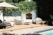 Sunny outdoor living beside a pool