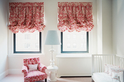 Red patterned balloon shades in a nursery