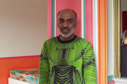 Designer Manish Arora leaning against the entry to his Paris bedroom