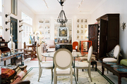 Upholstered chairs surrounding a round glass table