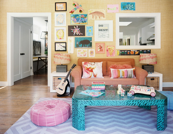 Eclectic Kids' Room - A gallery wall of art and kids' creations in a pattern-filled family room