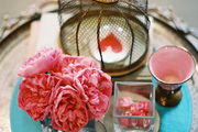 Flowers, candles, and decorative accessories on a side table