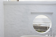 A porthole window with views of the ocean