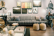 A gathering of art above a black-and-white couch
