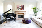Living room with grand piano and star wars art.