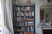Built-in bookshelves around the fireplace in the couple's bedroom are testament to their love of the printed word.