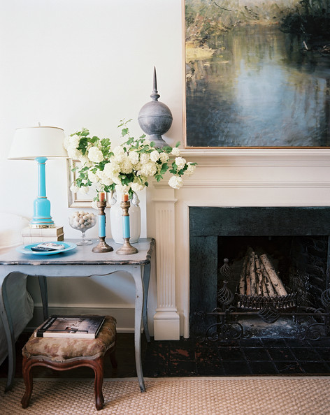 Fireplace - A blue end table beside a fireplace