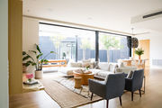"""A linen sectional sofa by Design Within Reach anchors the Stevens' family room. The duo admit they went """"back and forth"""" before eventually settling on this modern, clean-cut design."""