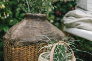 A detail of two boho baskets holding plants.