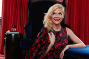 Jaime King in a living space with red velvet draperies