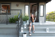 Actress Katie Lowes in front of her Crasftman-style home