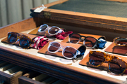 Eyewear by Saint Rita Parlor in a distressed desk at Hammer and Spear