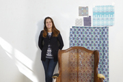Molly Andrews of Chairloom, with potential fabric choices for a chair to be reupholstered