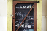 Vintage cupboard filled with dining ware.