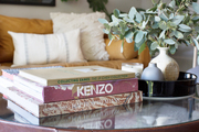 A detail of books on a coffee table.