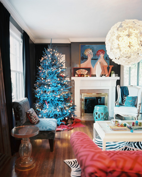 Holiday Decor - A Christmas tree in the corner of living room with dark-gray walls and an oversize light fixture