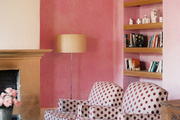 A pair of polka-dotted chairs in a pink guest room