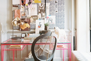 A pink desk paired with a gray chair