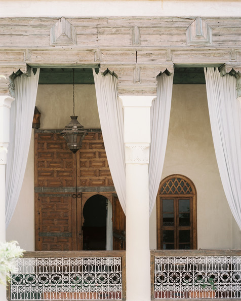 Iron Patio - An open-air walkway accented with Moroccan architecture
