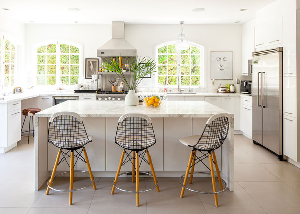 Island - A trio of wire chairs at a Calacatta Gold marble kitchen island