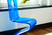 A blue chair detail in the home of Jordana Brewster
