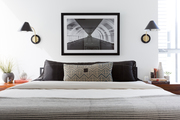 A contemporary bedroom with black and white accents.