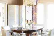 Mies van der Rohe Brno chairs and a DwellStudio Draper rug with a custom-painted light fixture and an antique chinoiserie screen