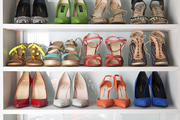 A collection of shoes on display in a well-curated closet