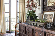 An antique sideboard on terra-cotta tile floors
