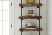 Vintage wood and metal shelving in white room.