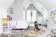 Tiffani Thiessen's daughter at play in her bright bedroom
