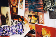 A basket of fabric samples beside a wall of inspirational images