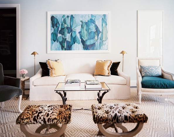 Lilly Bunn Weekes - A neutral living space with accents of blue and leopard print