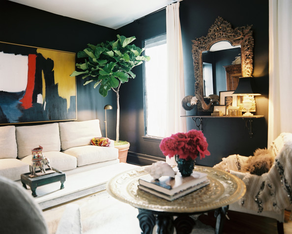 Living Room - A black living space brightened by art and neutral furniture