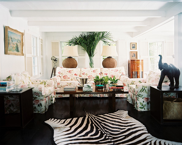 Living Room - A floral couch and armchairs and a zebra rug in a living space