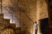 A staircase leading to a wine cellar located in a cave